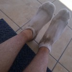 Socks and legs covered in Kalahari sand.