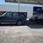 Range Rover P38 with a loaded trailer and coil springs.